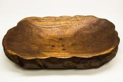 果子盘子由柚木树木头制成 免版税图库摄影