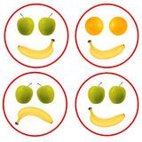 果子面孔被隔绝在白的香蕉,桔子,苹果 库存照片
