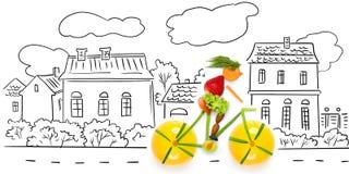 水果的骑自行车者。 库存照片