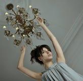 枝形吊灯妇女 图库摄影