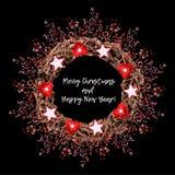 枝杈圣诞节花圈在黑背景的 库存照片