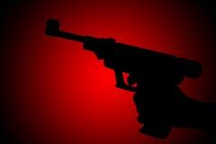 枪剪影 免版税库存照片