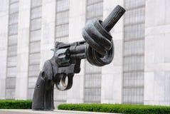 枪团结的被打结的国家 库存照片