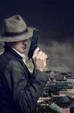 枪手在城市 免版税库存照片