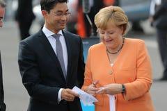 柏林- 9月11 : Philipp Rösler和Angela Merkel 库存照片