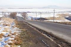 柏油路在冬天 免版税库存图片