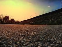 柏油路在阳光下 库存照片