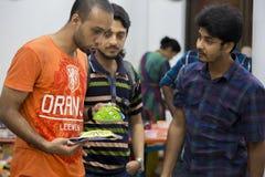 某些庆祝即将来临的孟加拉新年的人咆哮的面具 免版税库存图片