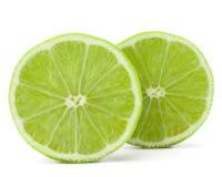 柑橘石灰在白色背景保险开关隔绝的果子一半 库存图片