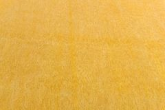 染黄色的墙壁纹理背景,由威尼斯式膏药的大理石 图库摄影