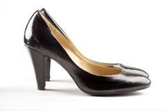 染黑皮革专利鞋子 库存照片