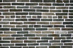染黑砖gery绿色墙壁 库存图片