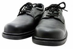 染黑鞋子 库存照片