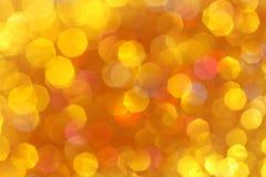 柔光桔子,金背景黄色,绿松石,桔子,红色抽象bokeh 免版税库存照片