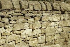 柔和曲调关闭了与透视角度墙壁的历史的石头在西西里岛意大利 免版税库存图片