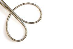 柔软的金属水管形成的双重曲线 免版税图库摄影