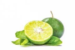 柠檬,切成两半和叶子在白色背景 免版税库存照片