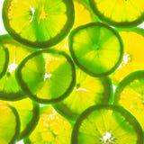柠檬,橙色横断面 库存照片
