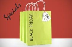 柠檬绿在红色白色背景的购物袋 库存照片