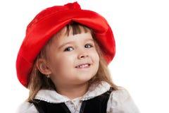 查出少许纵向红色骑马的儿童敞篷 免版税图库摄影
