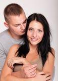 查出的一对美好的新愉快的微笑的夫妇的纵向 库存照片