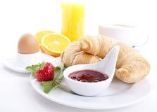 查出的传统法国早餐新月形面包 库存照片