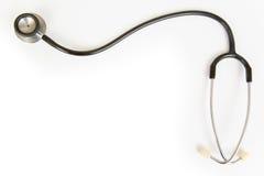 查出的听诊器 免版税库存照片