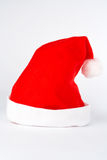 查出的圣诞节帽子 免版税库存照片