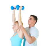 查出的夫妇健身 免版税库存图片