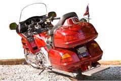 查出的摩托车红色 免版税库存照片