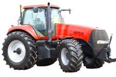 查出的新的红色拖拉机 免版税库存照片