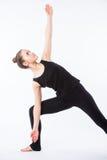 查出的模型部分姿势摆在系列多种战士白人妇女瑜伽年轻人 这是一系列的各种各样的瑜伽姿势的一部分由这个模型,隔绝在白色 库存图片
