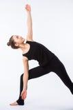 查出的模型部分姿势摆在系列多种战士白人妇女瑜伽年轻人 这是一系列的各种各样的瑜伽姿势的一部分由这个模型,隔绝在白色 库存照片