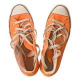 查出的橙色鞋子白色 库存图片