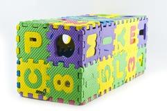 查出的橡胶七巧板配件箱。 图库摄影