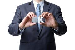 查出的生意人好显示符号白色 免版税库存图片