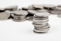 查出的硬币堆 免版税库存照片