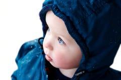 查出的穿蓝衣的男孩外套 免版税库存图片