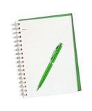 查出的笔记本笔白色 免版税库存照片