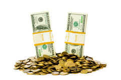查出的美元和硬币 免版税库存照片