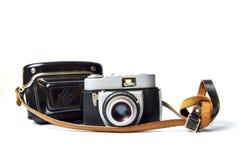 查出的老影片照相机 免版税库存图片