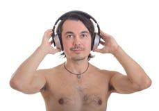 查出的耳机供以人员立体声空白年轻人 免版税库存图片