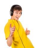 查出的耳机供以人员空白年轻人 图库摄影