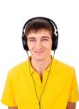 查出的耳机供以人员空白年轻人 库存照片