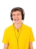 查出的耳机供以人员空白年轻人 免版税图库摄影