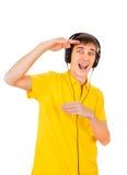 查出的耳机供以人员空白年轻人 免版税库存照片