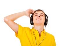查出的耳机供以人员空白年轻人 库存图片
