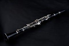 查出的背景黑色单簧管 免版税库存照片
