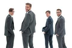 查出的背面图白色 一个小组成功的商人 我 免版税库存图片