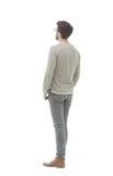 查出的背面图白色 全长 灰色毛线衣的年轻人 免版税图库摄影